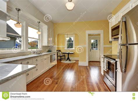 Kitchen Yellow Walls White Cabinets kitchen interior with white cabinets yellow walls and