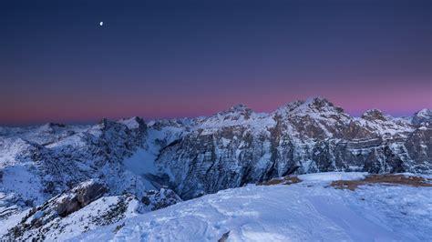 snowy mountain  night time  wallpaper