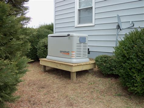 20 kw residential generac on a raised platform serviced by