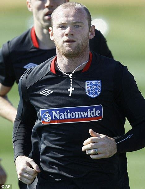 wearing rosary wayne rooney reveals his world cup luck charm as he