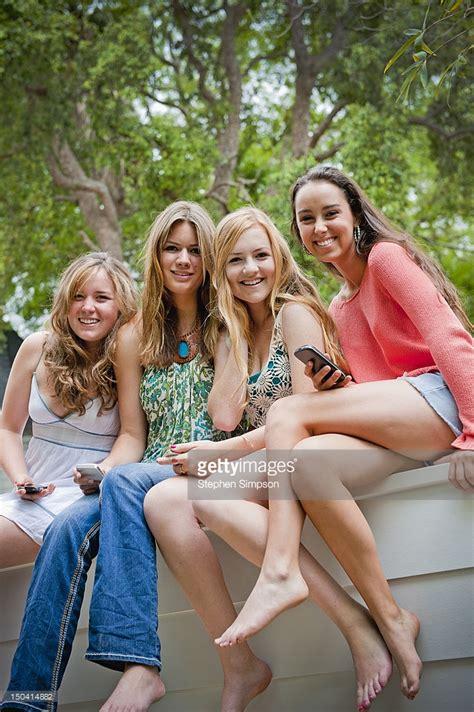 backyard babes 4 teen girls affectionate backyard portrait stock photo