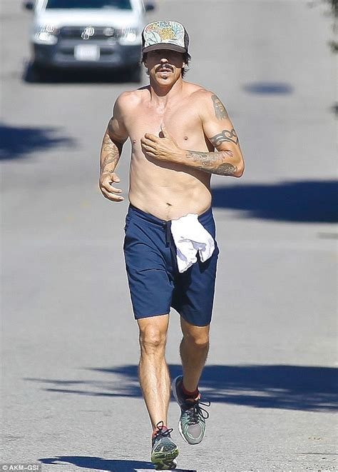 anthony kiedis on a shirtless jog after discussing red