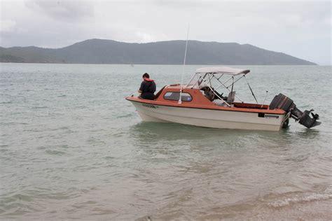 small fishing boat anchors anchoring a small boat while cing onshore 100 magic