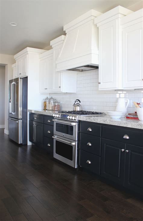Lower Kitchen Cabinets by Show N Tell In One Parade Home Navy Cabinets