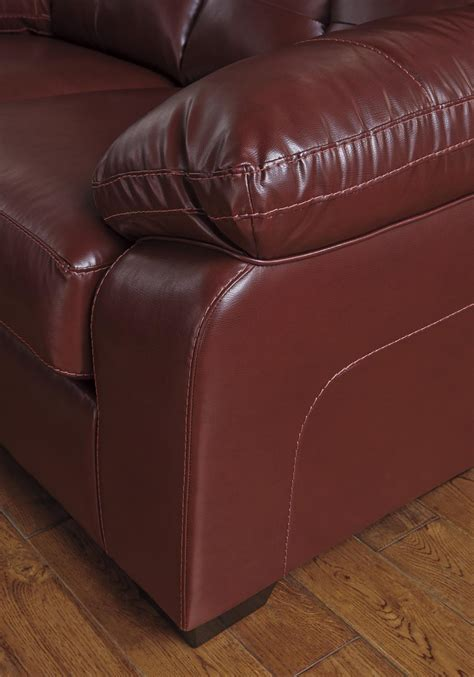 red leather couch and loveseat benchcraft by ashley bastrop 4460238 4460235 red leather
