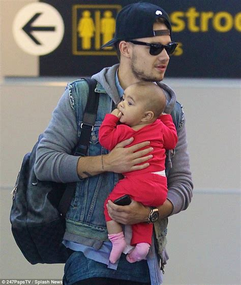 boy it s a hot one one direction s liam payne cradles a friend s baby daily