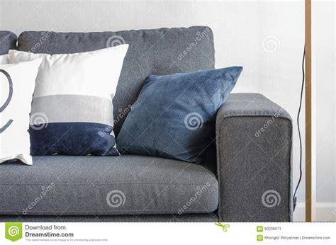 blue throws for sofas blue pillows on modern grey sofa stock image image 60208671