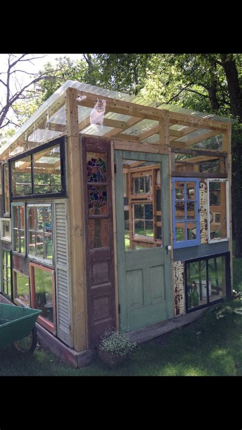 recycled windows barnwood doors stained glass greenhouse