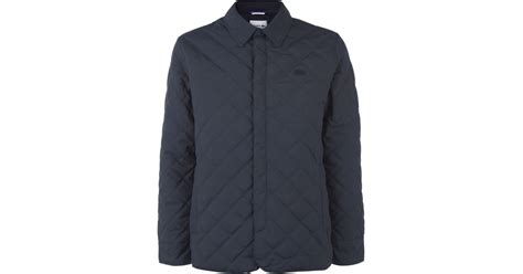 lacoste quilted jacket in blue for lyst