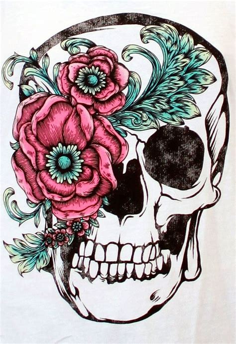 beautiful skull and flower accent good for a thigh tattoo