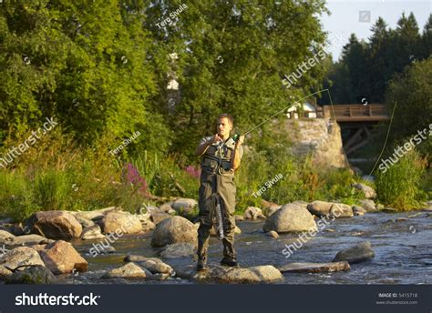 Wading Pic by Wading In A River Fly Fishing Stock Photo 5415718