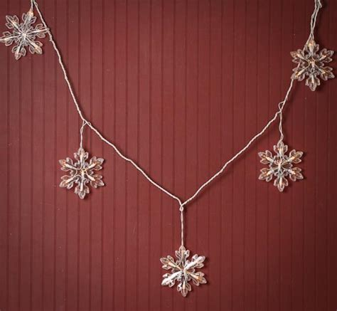 Snowflake String - clear large snowflake bulb and white cord string lights