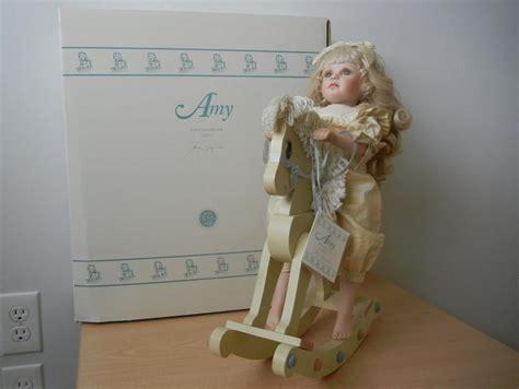 porcelain doll on rocking vintage porcelain doll with wooden rocking and