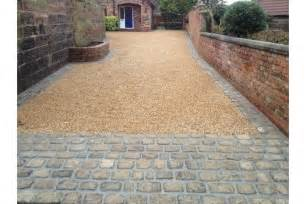 gravel driveway with stone apron and edge sopo house
