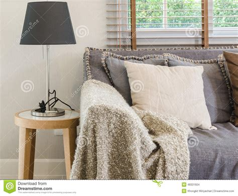 blanket on sofa brown blanket on sofa with l in living room stock photo