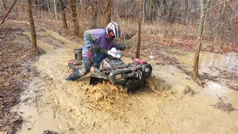 mudding four four wheeler stuck in mud youtube