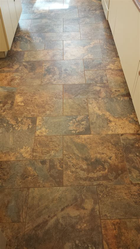 This is a modular vinyl tile from Armstrong Alterna. The
