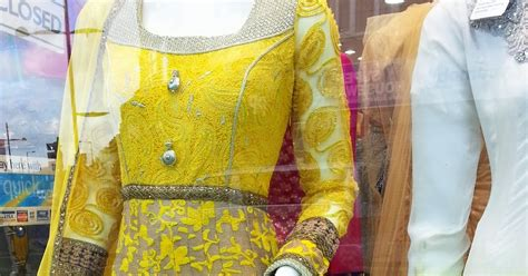 Aqila Dress 2 curly fries high designs yellow flowers and paisleys