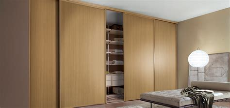Sliding Door Systems For Wardrobes by Oak Wardrobe Sliding Doors Sliding Wardrobes Uk Torino