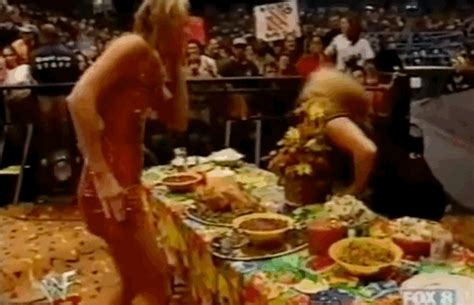 torrie wilson thanksgiving gif today in history stacy keibler vs trish stratus in a