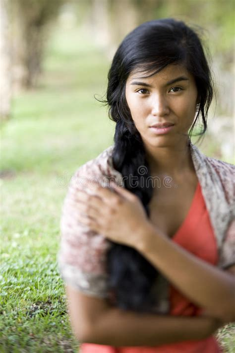 is japenese hair straightening harmful for middle aged women portrait of beautiful young pacific islander woman stock