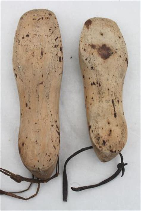 wooden shoe slippers wooden foot shaped wood blocks to form shoes or