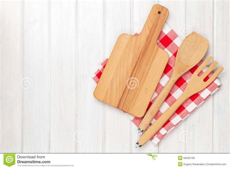 kitchen utensils over white wooden table background stock