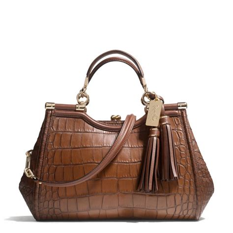 Coach Emboss the carrie in croc embossed leather from coach