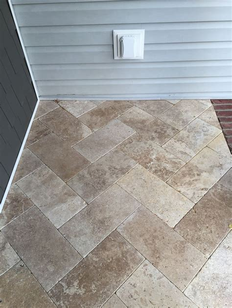 we used travertine tile in the herringbone pattern for our