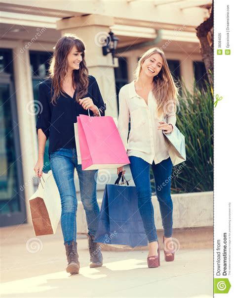 Entrance Hall Ideas two young women shopping at the mall royalty free stock