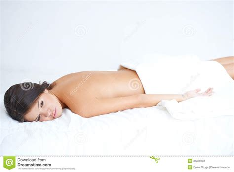 lying on the bed cute brunette lying on spa bed stock photos image 33034933
