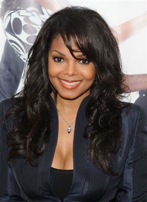 janet jackson long layered hairstyles from the 80s and 90s long curly hairstyle with bangs for black women janet
