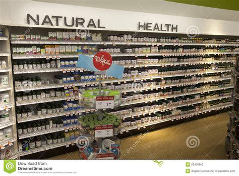 wellness shop vitamins health shop shelves pharmaceutical products