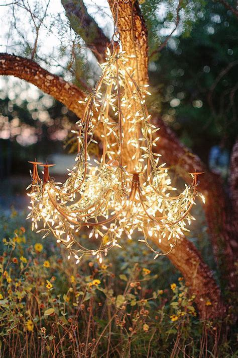 outdoor string light chandelier how great would it look if you wrapped lights around a