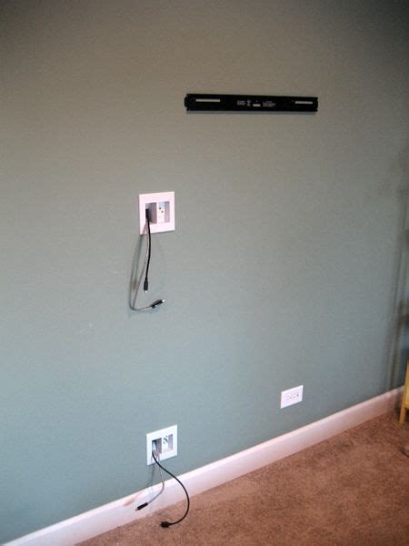 hiding cable wires along wall hiding tv cords hanging tv and cords on