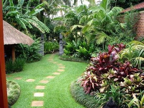 how to plant a backyard garden brick wall and tropical plants for elegant backyard