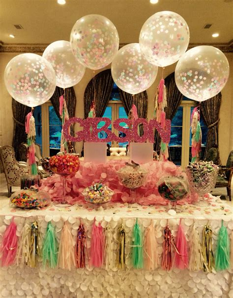 gorgeous sweet 16 candy buffet with tassel confetti