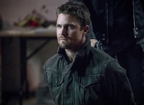 dragon tattoo on oliver queen s back arrow oliver queen goes back to jail in the new promo for