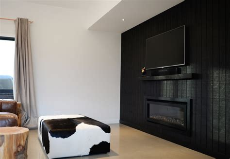 black feature wall living room black feature wall tv positioning black cladding open plan living minimalist living living room