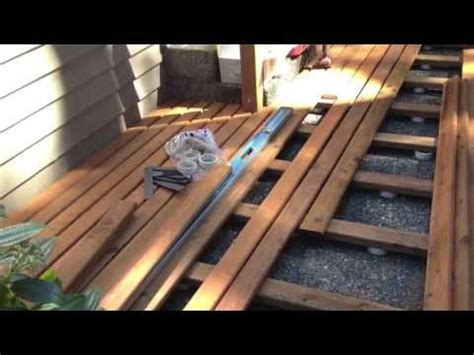 Installing Pavers In Backyard How To Build A Floating Deck Youtube