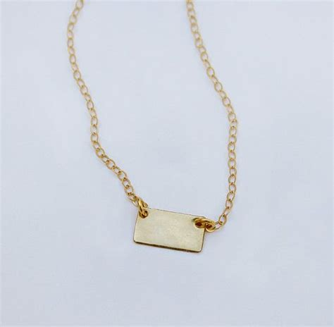 Forget Me Not Necklace P 178 small rectangular gold tag necklace minimal modern by shopluca accoutrements minimal