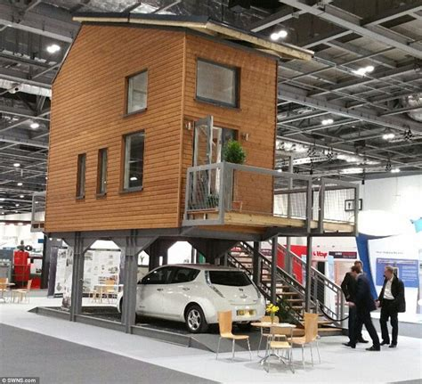 cover has a plan to solve the housing crisis with backyard granny architect designs tiny flats to stand on stilts above car