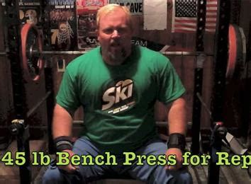 345 bench press most reps bench pressing a 345 pound barbell athlete