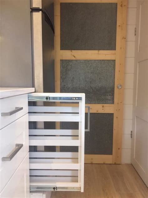 tiny house storage solutions tiny home on wheels with adjoining patio and green house