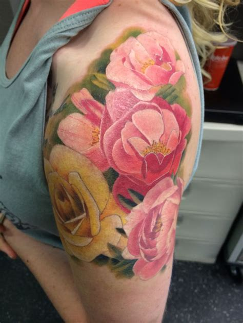 tattoo shops joplin mo pink and yellow flowers by wade rogers of