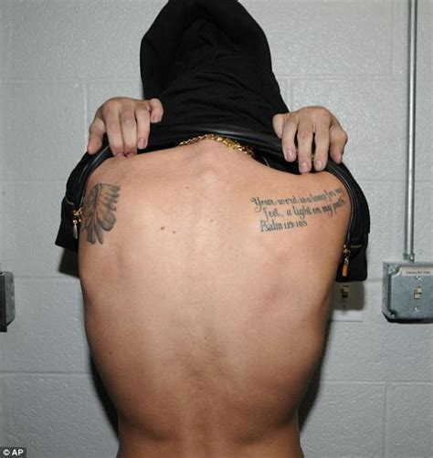 Justin Bieber Tattoo On Back | justin bieber shows off tattoos in miami jail following