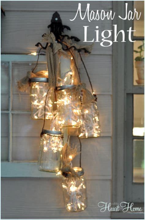 how to make mason jar lights with christmas lights diy mason jar light all things heart and home