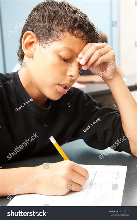 finishing school a boy is sent to a finishing school an lgbt books handsome school boy struggling finish test stock photo