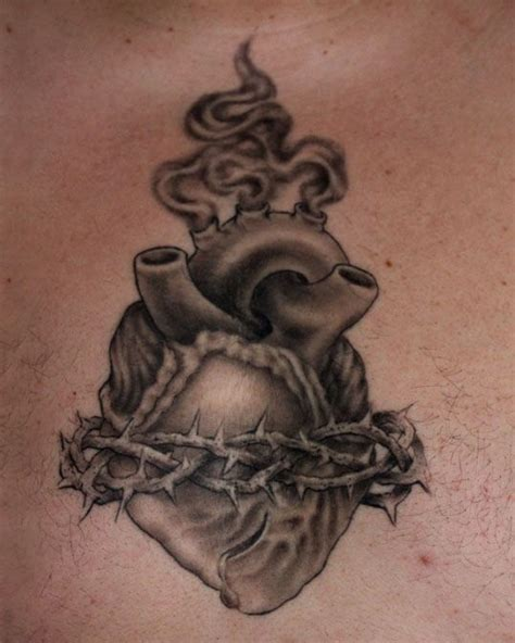 realistic heart tattoo designs realistic sacred inked by edwin marin http