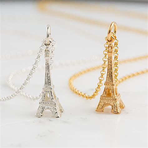 gold eiffel tower necklace by charmed